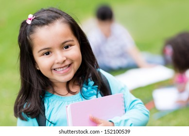Portrait of a cute girl looking happy at the school