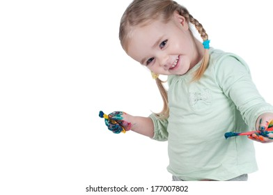 Portrait of cute girl painting with paintbrush