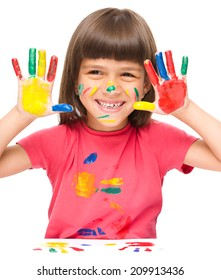 Portrait of a cute girl showing her hands painted in bright colors, isolated over white