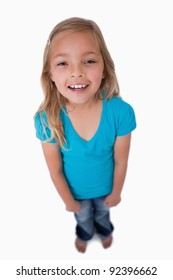Portrait of a cute girl smiling at the camera against a white background