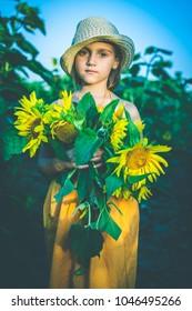 Portrait of cute girl in sunflowers field