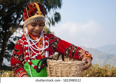 Portrait of a cute girl in traditional outfit of north west Indian ex: Darjeeling.