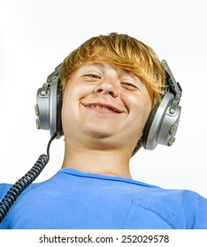 portrait of cute handsome boy listening to music by headphones