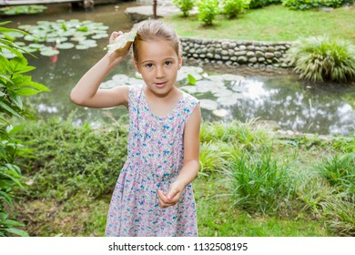 Portrait of cute happy child in nature, beautiful spring day at park