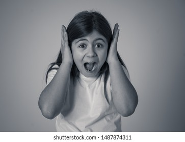 Portrait of Cute happy, excited, funny, cheerful young girl with shocked surprised face finger pointing out at something good and unexpected. In children and Positive human emotions and expressions.
