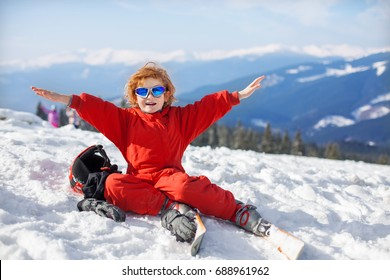 portrait of cute happy skier boy in a winter ski resort, skiing, winter sport, little boy skier portrait with helmet and his snow gear at winter holiday.