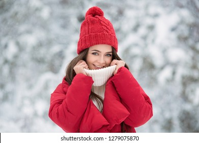 Portrait of cute happy woman outdoor. Winter forest.