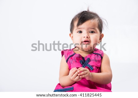 246d13485 portrait of cute indian baby girl, asian baby girl indian girl child  closeup over white