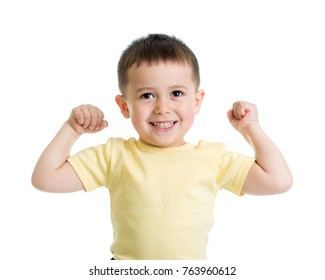 Portrait of cute kid boy showing the muscles of his arms, isolated on white