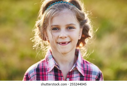 Portrait of cute kid. Country style