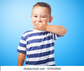 portrait of a cute kid covering his mouth with his hand