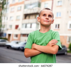 Portrait of a cute kid outdoor in urban environment