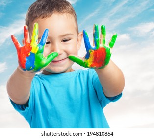 portrait of cute kid playing with paint