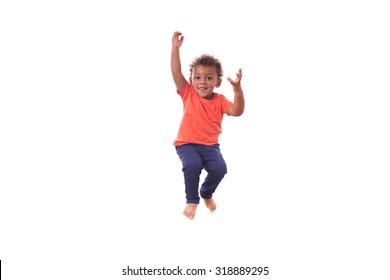Portrait of a cute little African American boy jumping on a trampoline