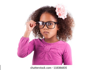 Portrait of a cute little African Asian girl wearing glasses,isolated on white background
