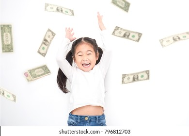Portrait of cute little asian girl throwing money isolated on white background. Small toddler asian girl counting her allowance dollar note(blur), rich people bill concept