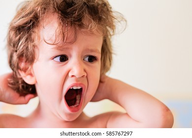 Portrait of a cute little baby boy kid yawning before sleep. Bed time