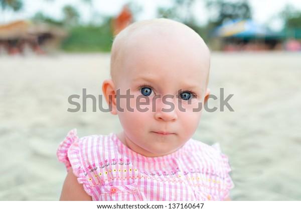 Portrait of cute little baby girl on the beach