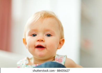 Portrait of cute little baby at home