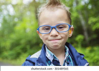 A Portrait of cute little boy child outdoors on the nature