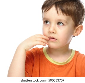 Portrait of a cute little boy looking doubtful, isolated over white