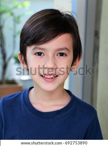 Portrait of a cute little boy mixed Asian European. Smiling face of a cute boy