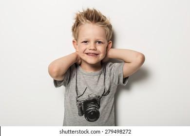 Portrait of cute little boy posing. Studio portrait over white background