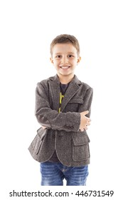 Portrait of a cute little boy posing over white background
