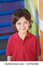 Portrait of cute little boy smiling in kindergarten