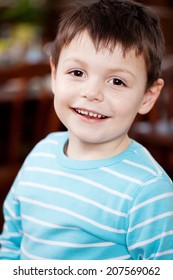Portrait of cute little boy smiling in restaurant