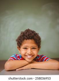 Portrait of cute little boy smiling in classroom
