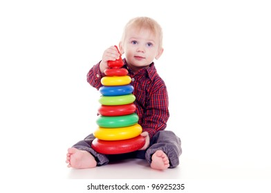 portrait of a cute little boy with toy