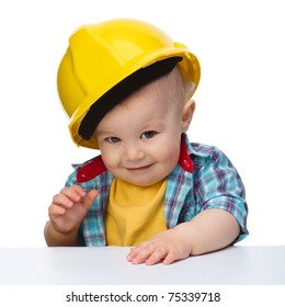 Portrait of a cute little boy wearing oversized hard hat, isolated over white