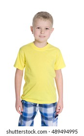 Portrait of a cute little boy in a yellow shirt on the white background