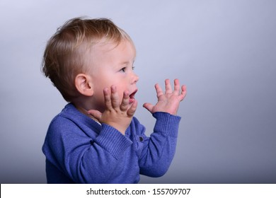portrait of cute little caucasian baby emotion wonder, joy tin. baby 1 year