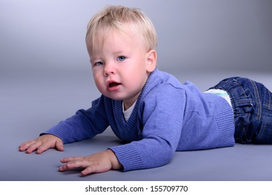portrait of cute little caucasian baby lies. baby 1 year