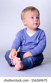 portrait of cute little caucasian baby sitting. baby 1 year
