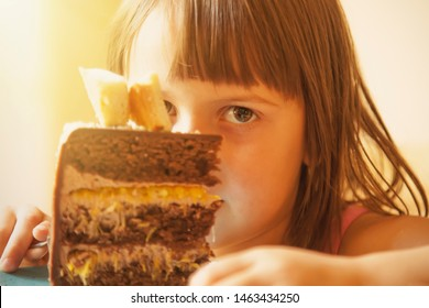 Portrait of cute little child girl with cake.
