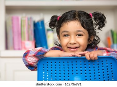 Portrait of a Cute Little Girl in the Classroom
