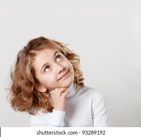 Portrait of cute little girl with dream