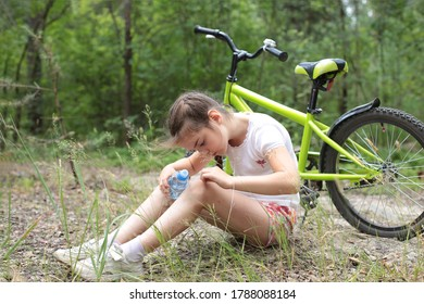 Portrait of a cute little girl of eight years old walks in the forest in nature