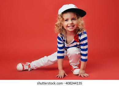 Portrait of a cute little girl in fashionable clothes. beautiful child