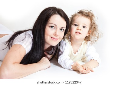 Portrait of cute little girl and her young mother