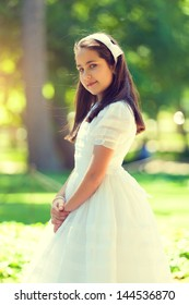 Portrait of a Cute Little Girl in her First Communion Day