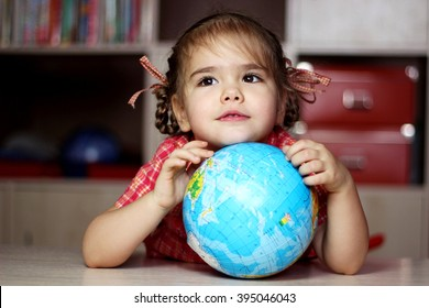 Portrait of the cute little girl hugging the earth globe, save the earth concept