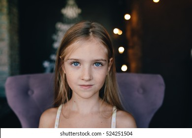 Portrait of a cute little girl on the background of Christmas decorations