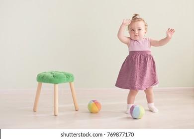 Portrait of a cute little girl in a pink dress
