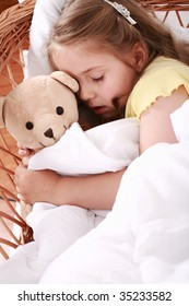 Portrait of cute little girl sleeping with teddy