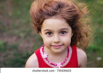 Portrait of cute little girl smiling outside