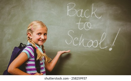 Portrait of cute little girl standing in the classroom